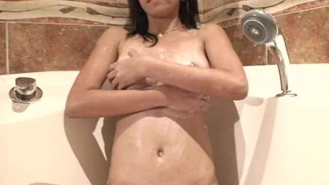 Sexy Filipina girl in tub rubs her titties for me